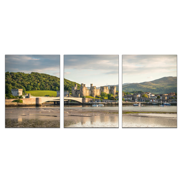 Canvas Wrap Triptych Wall Art - Conwy Castle, Harbour & Quay. An early evening panorama of Conwy Castle and Quay with the glow of sunset bathing the castle in a nice, soft light.