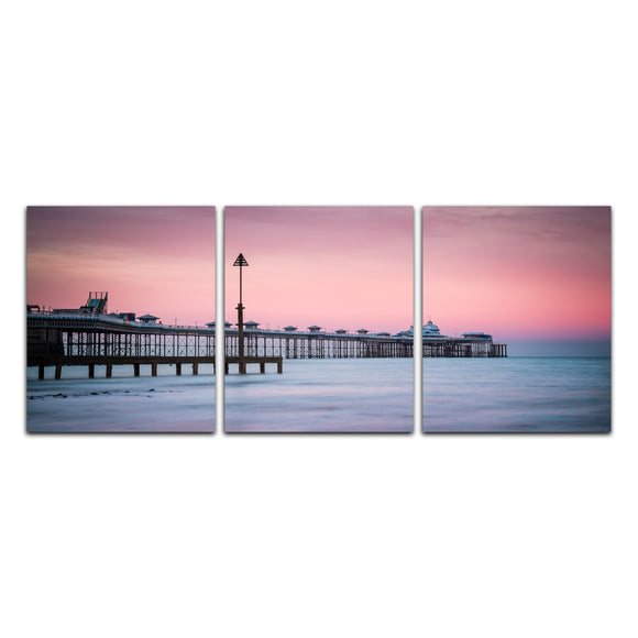 Canvas Wrap Triptych Wall Art - Pastel colours fill the sky as the pinks and blues of sunset reflect on the sea at Llandudno Pier, North Wales. Smart Imaging & Framing Landscape Photography