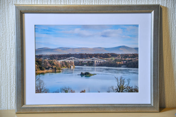 Mounted & Framed Print of Blue Sky at Menai Bridge, Anglesey by Smart Imaging & Framing North Wales. This item is offered for sale in our EX DISPLAY gallery