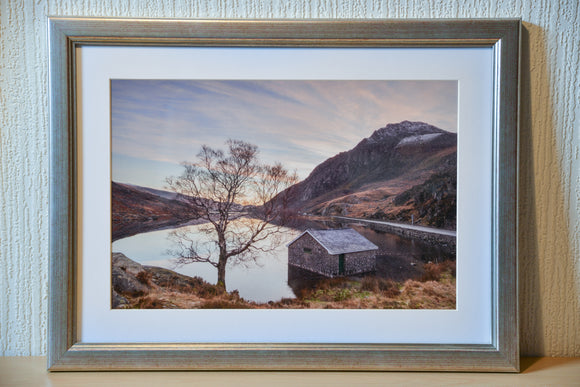 Just after the sunrise on this Winter's day at Llyn Ogwen in Snowdonia National Park. The snowcapped mountain of Tryfan stands tall next to the calm waters of the lake. Smart Imaging & Framing North Wales