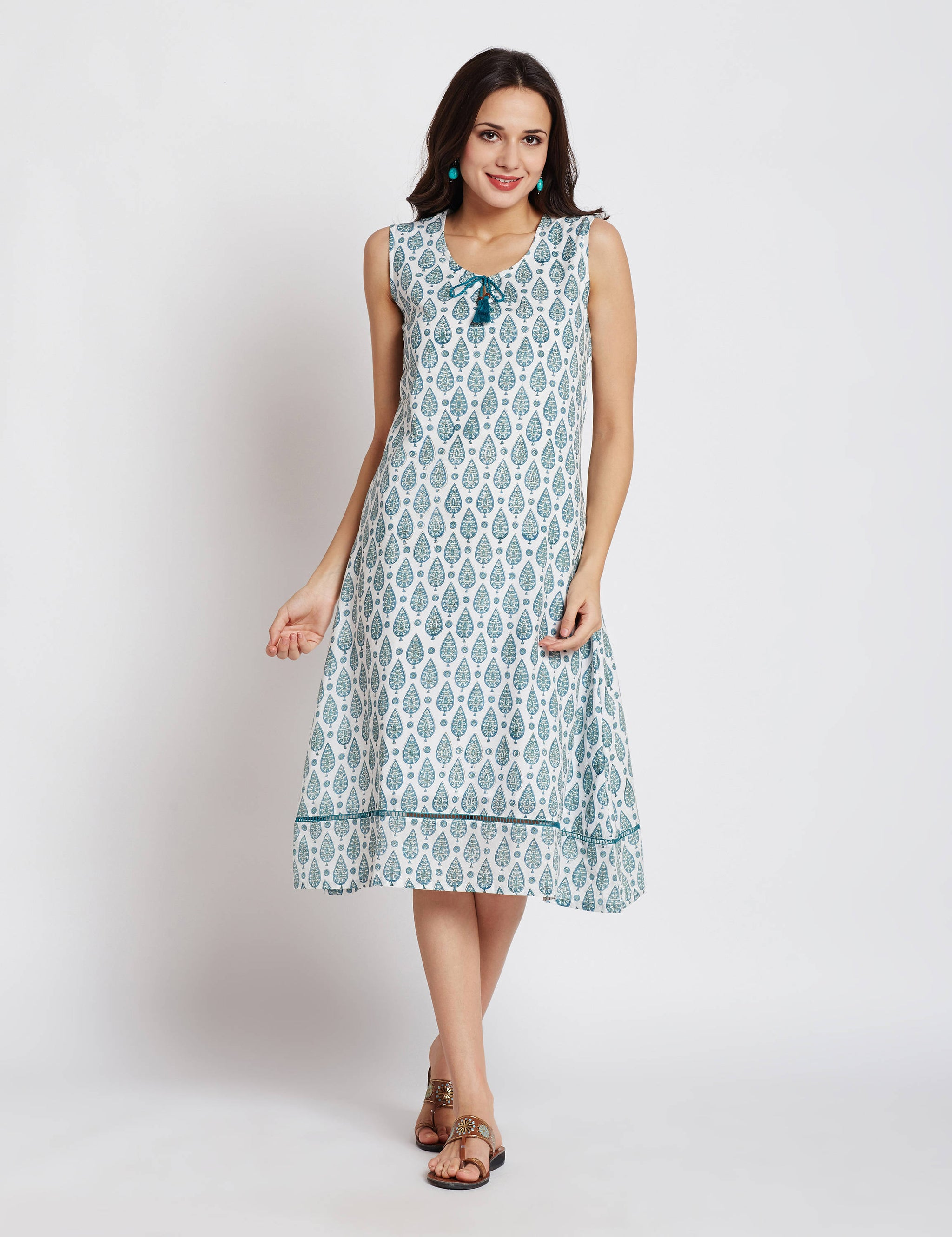 Hand block one piece sleeveless white dress with aqua green leaf print