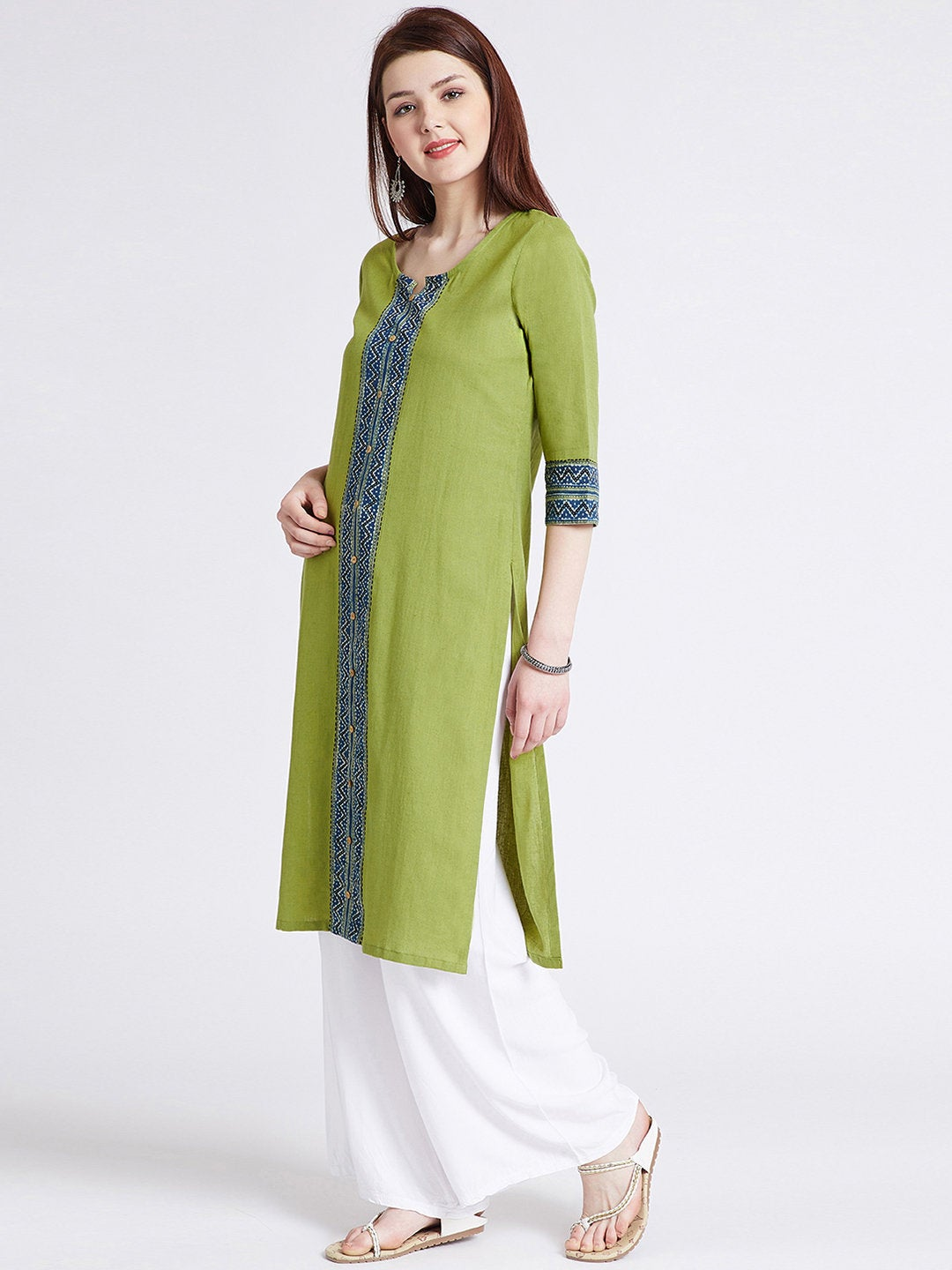 Indian ethnic long kurta with pocket in green colour with hand block printed ajrakh border detailing