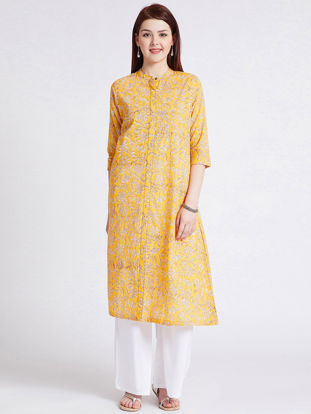 Indian ethnic hand block printed long kurta with front slit in turmeric yellow colour with pockets with button detailing on front