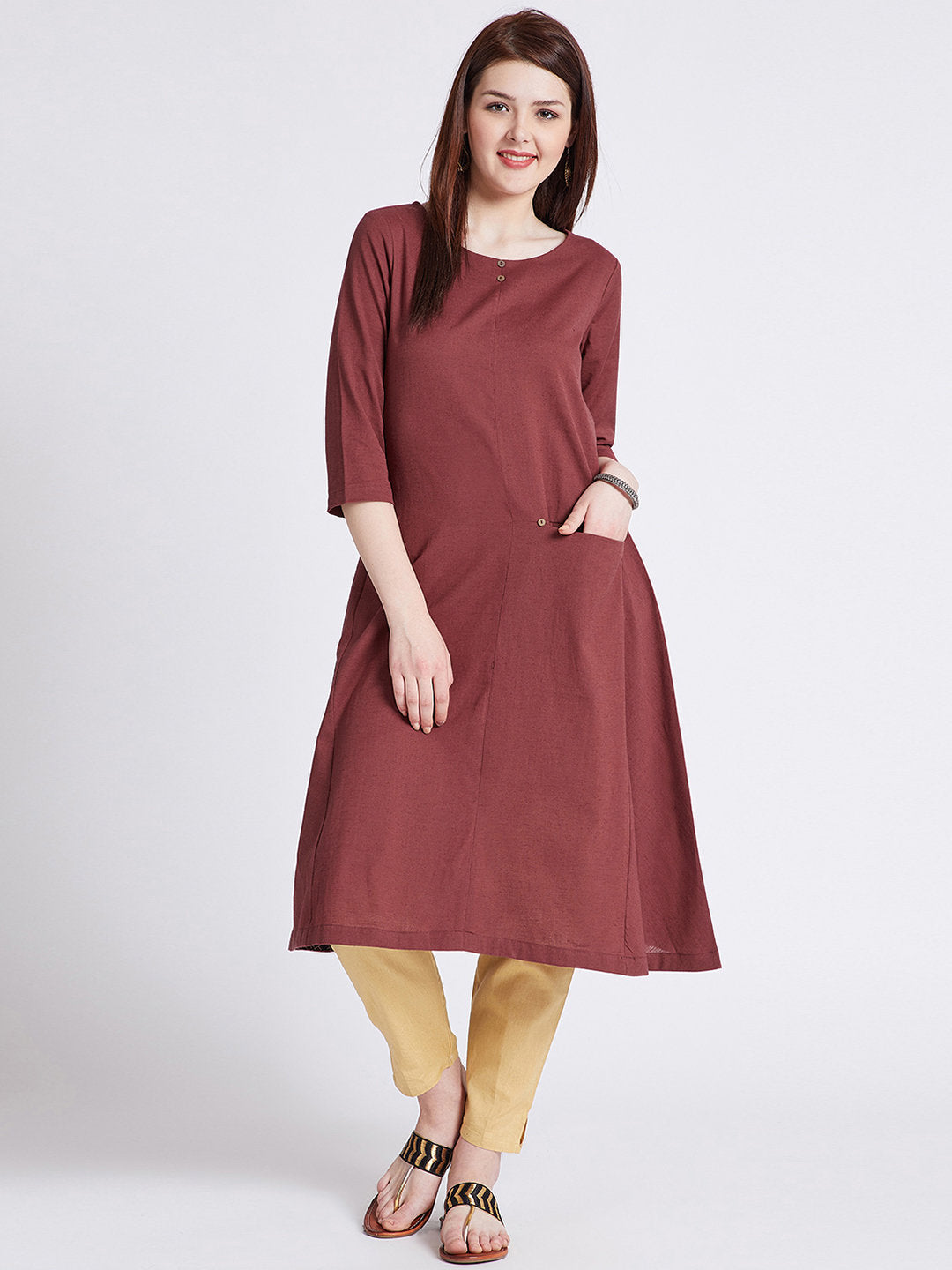 Indian ethnic long kurta with front pocket in rust colour with button detailing on front & round hem