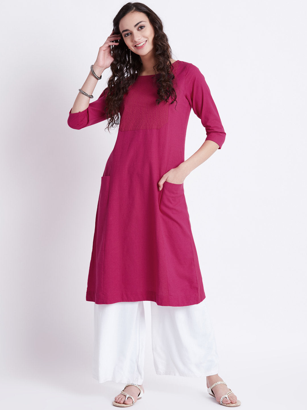 Indian ethnic long kurta with pockets in hot pink colour with embroidery detailing on yoke