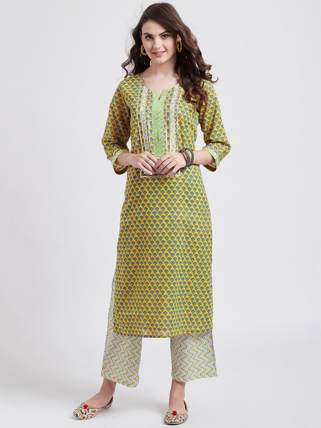 Hand block printed yellow kurta with gota detailing and hand block printed pants