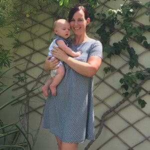 Happy Smart Mum In Modern Tunic Light Dress