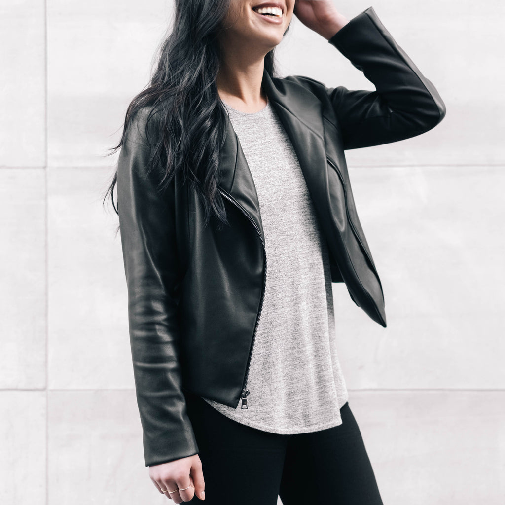 Working girl on the go wearing the Do Anything Jacket, must-have work wardrobe essential