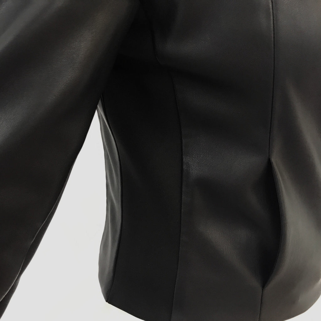 Moto jacket with luxe performance materials for 4-way stretch, made with engineered alternative vegan leather, minimalist modern design