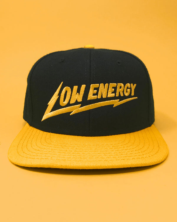 The Low Energy snapback hat in yellow and black.