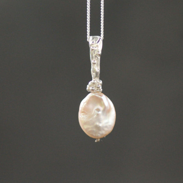freshwater cultured pearl on a sterling silver bail