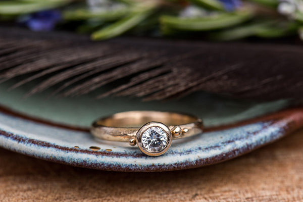 Solitaire style engagement ring