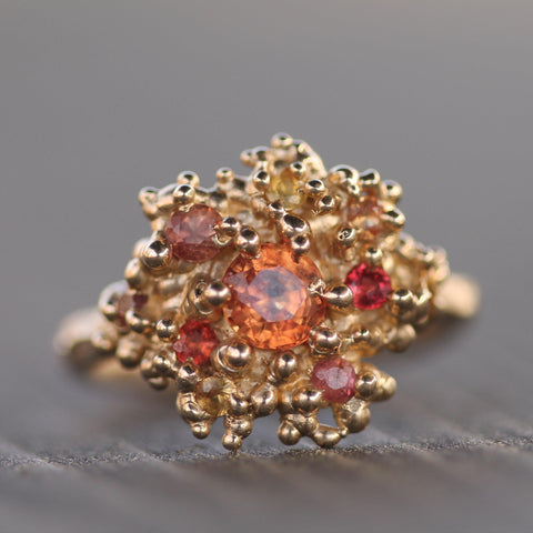 Hand carved 14k yellow gold ring with orange, pink and yellow sapphires