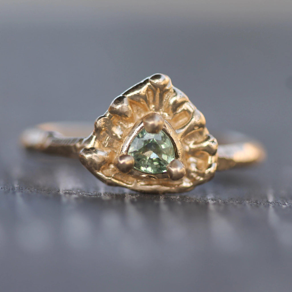 Trilliant cut green sapphire set in 14k yellow gold ring