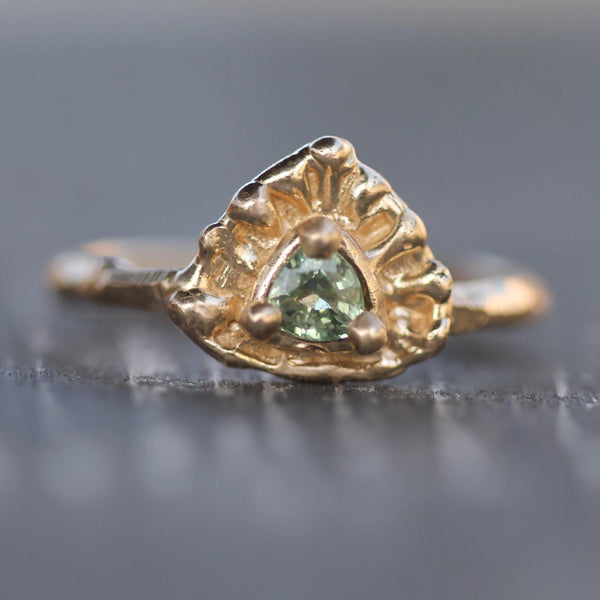 Hand carved 14k yellow gold ring with a beautiful green sapphire
