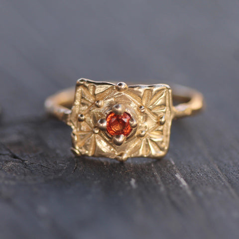 Hand carved orange sapphire gold ring