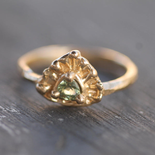 Pictured from above to show the golden bubbles and hand carved nature of the design