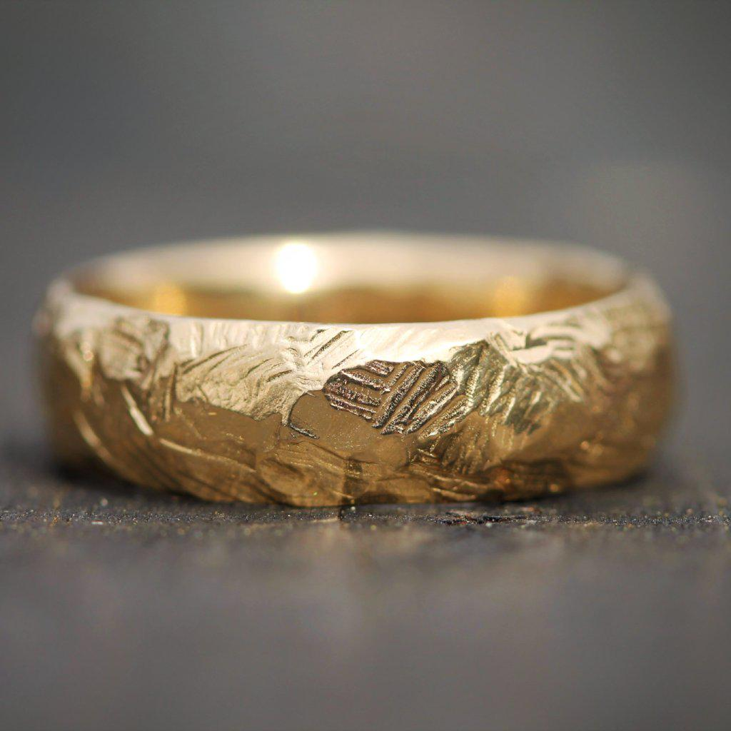 Hand carved jasper band inspired by mountain ranges in yellow gold