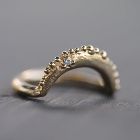 Hand carved gold stacking ring with diamond