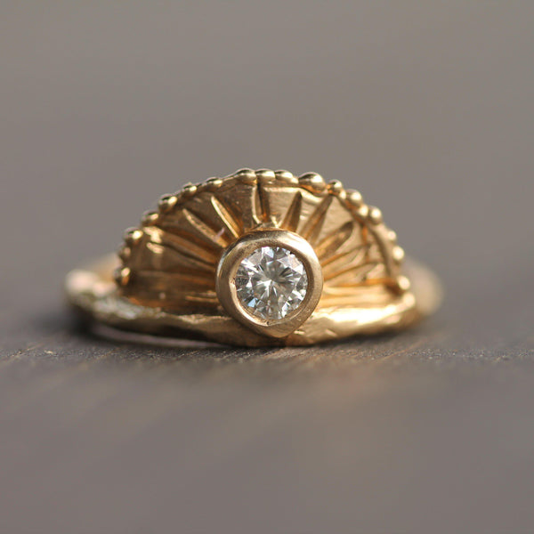 Golden sunrise surrounding a 3mm diamond or white sapphire