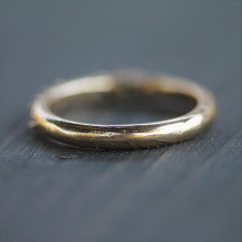 Hand carved gold band in 14k yellow gold