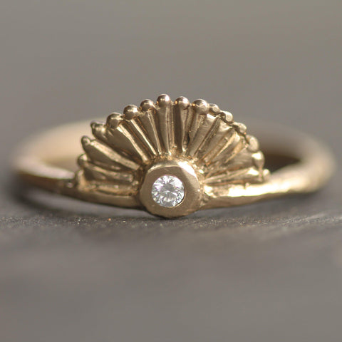 Delicate sunrise inspired diamond ring