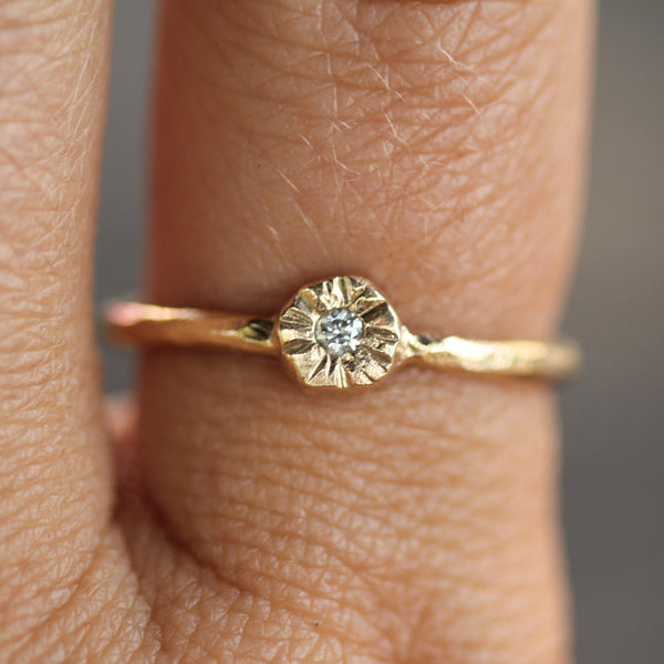 2mm diamond in a little sun setting ring