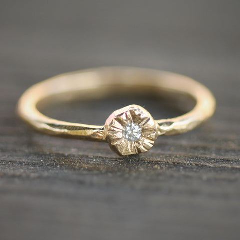 Simple, hand carved diamond ring set in a little sun ring