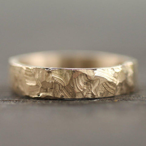 Hand carved mountain inspired band with a flat edge
