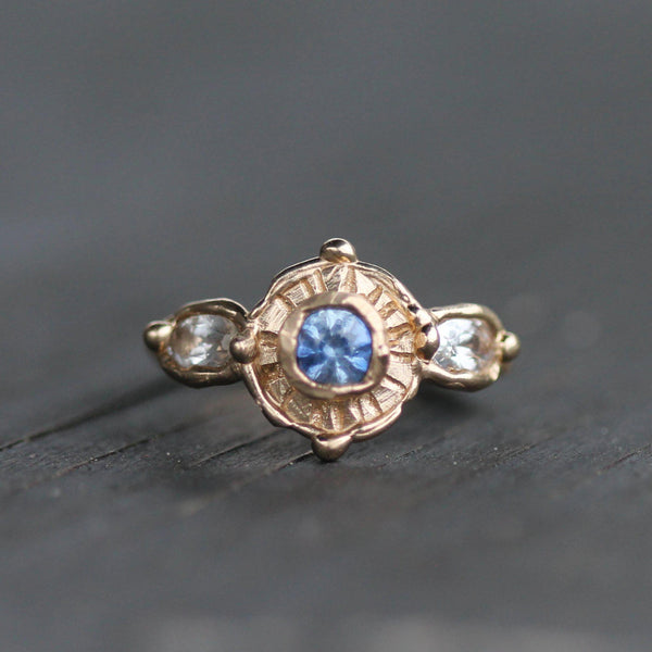 Hand carved 14k yellow gold ring featuring bule and white sapphires