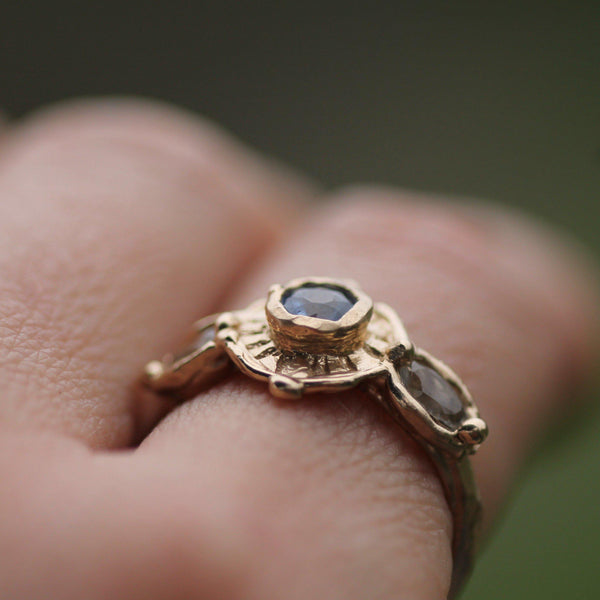 Pictured from above showing the height of the centre blur sapphire on hand
