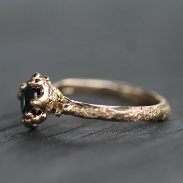Golden ring showing the sand inspired texture and melted bubbles