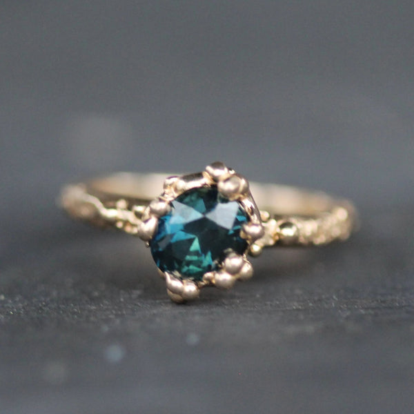 Mermaid treasure golden ring with teal sapphire