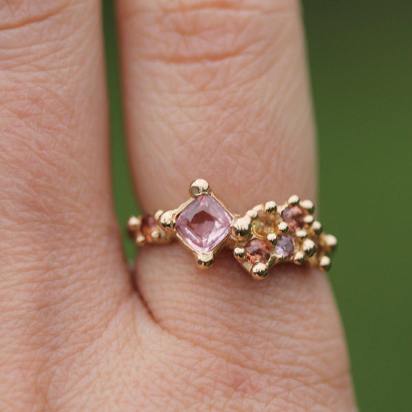 Sapphires and gold bubble ring pictured on hand