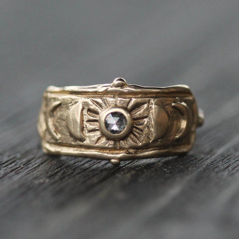 Gold ring with hand carved moon designs