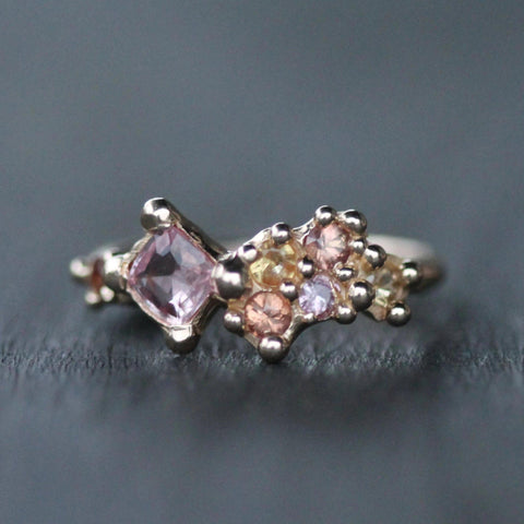 A beautiful array of orange, pink and yellow sapphire set in 14k yellow gold