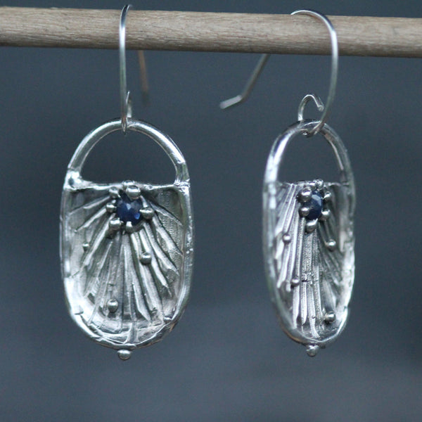 Hand carved sterling silver earrings with blue sapphires
