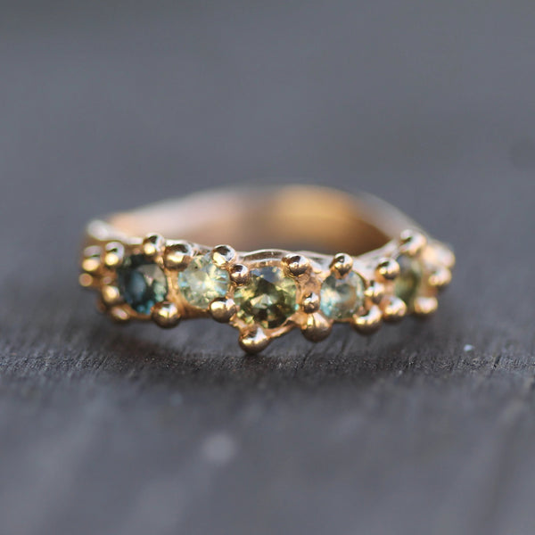 Hand carved 14k yellow gold ring with 5 sapphires