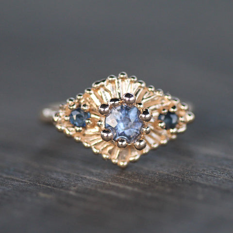 Blue sapphire ring made in 14k yellow gold.