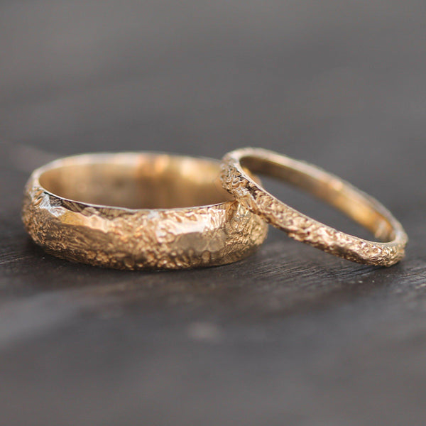 Wider and thinner textured gold bands