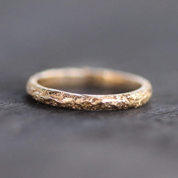 Hand carved gold wedding band