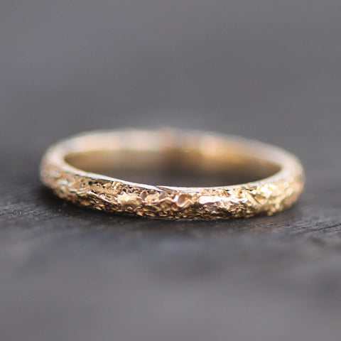 Sand textured band in 14k yellow gold