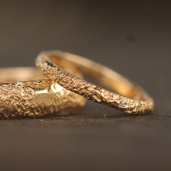 Close picture of sand textured wedding bands