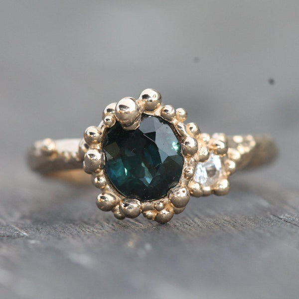 1.45ct deep blue green sapphire with 2.5mm white sapphire
