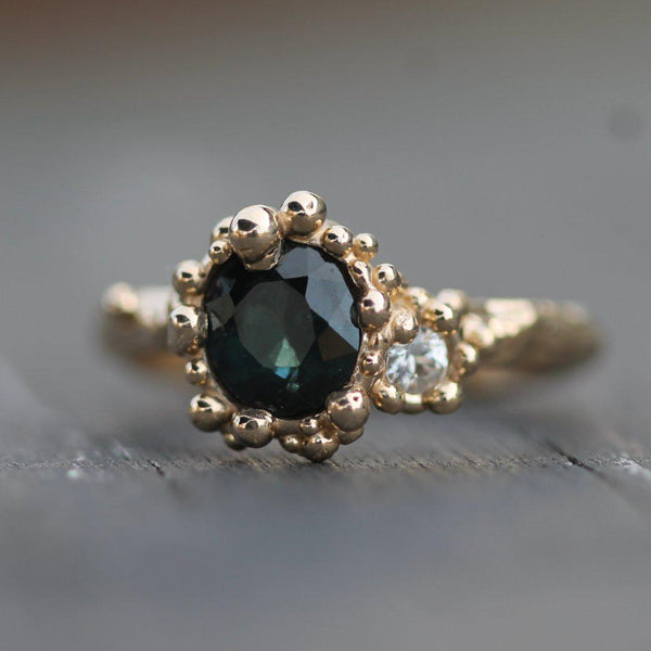 14K yellow gold ring surrounding the sapphires with golden bubbles