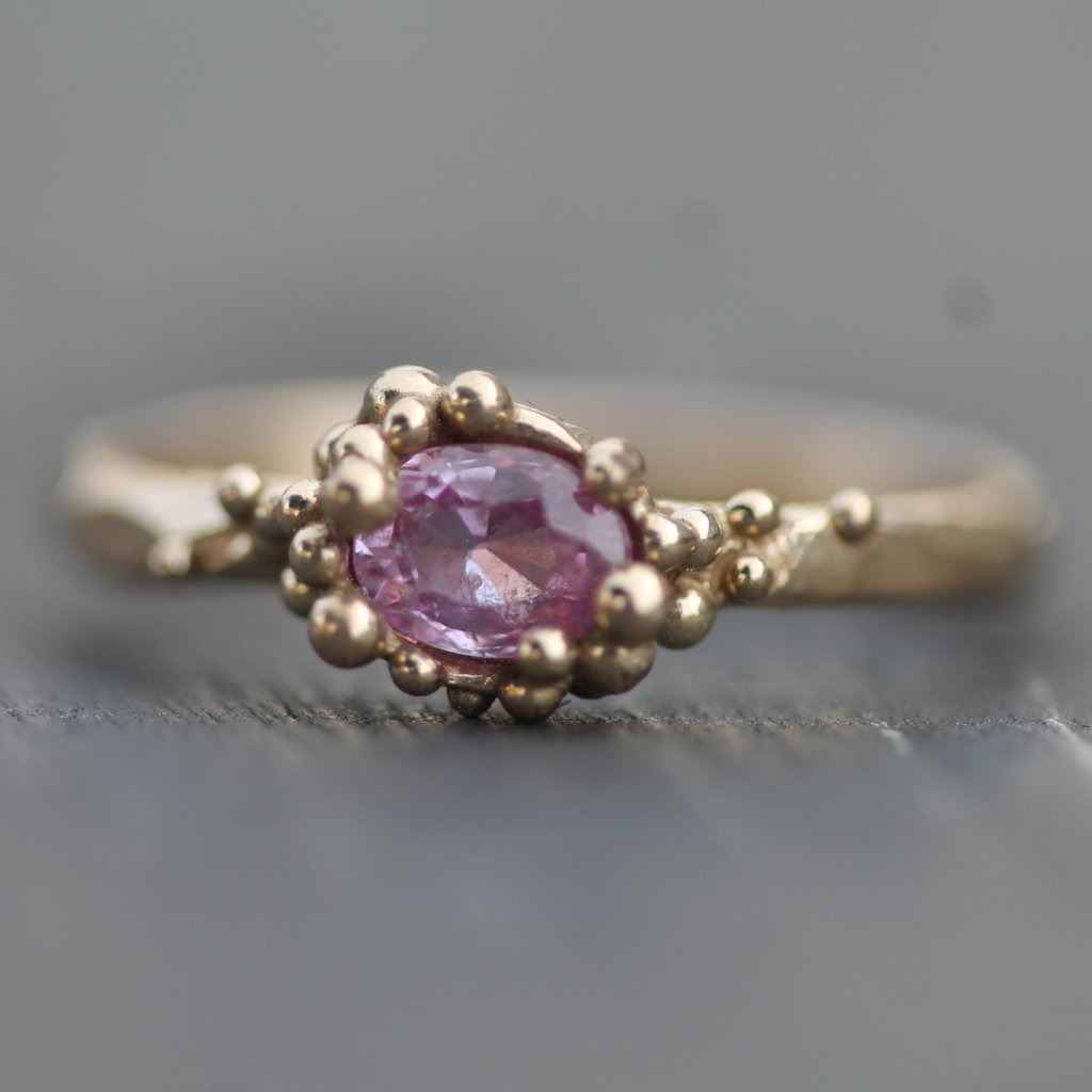 14k yellow gold ring with a beautiful pink sapphire