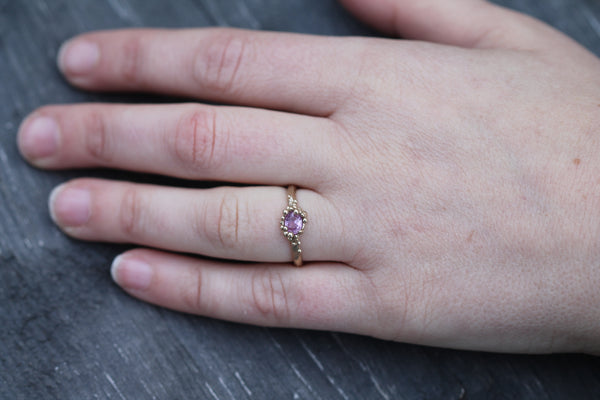 Pink sapphire mermaid treasure ring pictured on hand