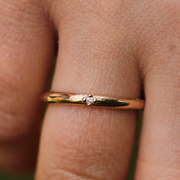 Smooth gold band pictured on hand