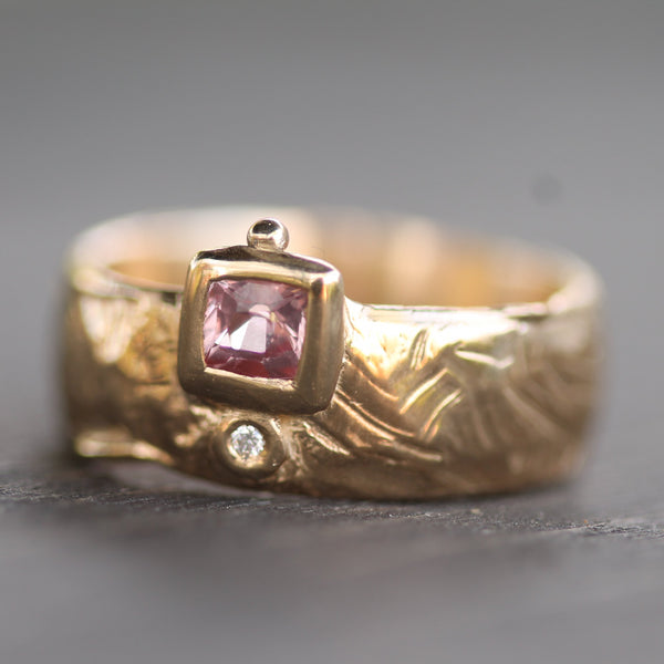 Golden 14k yellow gold thick band with beautiful pink sapphire and diamond