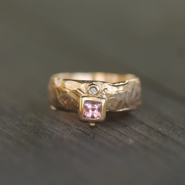 14k yellow gold ring with 3.5mm x 3.5mm pink sapphire